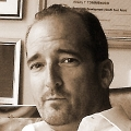 Michael J Aumock
