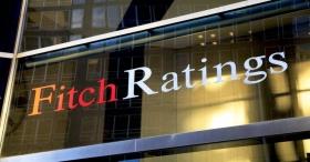 Fitch: налог на