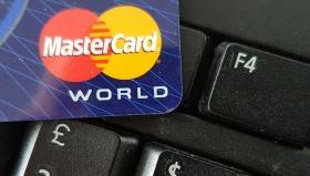Mastercard понизила